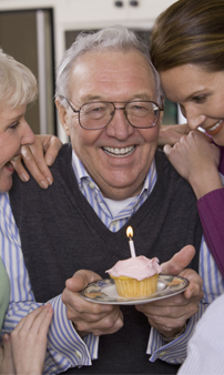 Man celebrating birthday with family
